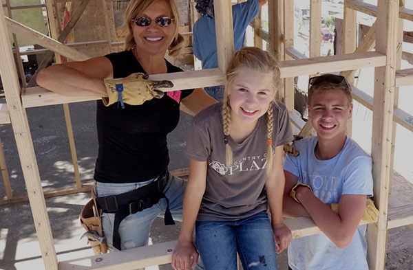 Image of Jill Tupper and her children building homes for those in need