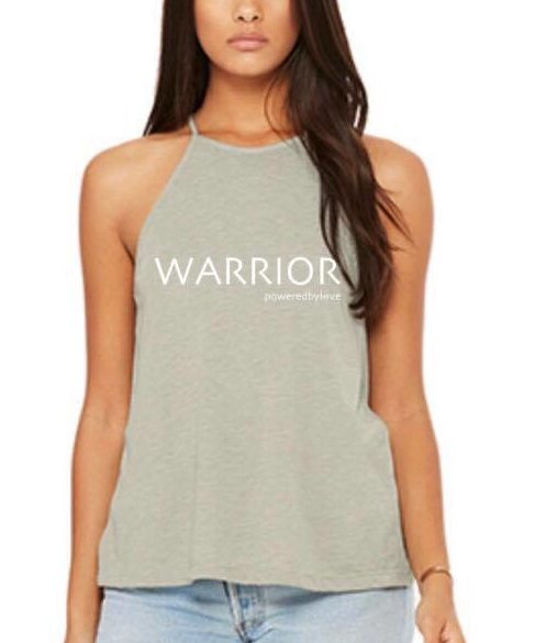 image of woman wearing a warrior powered by love tank top
