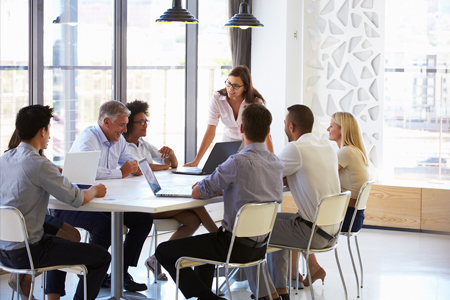 Image depicting positive corporate culture with a diverse group of people in a meeting